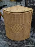 (R1) CORNER WICKER LAUNDRY BASKET WITH INTERIOR WHITE LINING. MEASURES 15 IN X 15 IN X 24 IN. ITEM