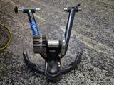 (R1) KINETIC BY KURT ROAD MACHINE BIKE TRAINER. MAY BE MISSING 1 OR 2 PIECES (NOT CERTAIN). ITEM IS