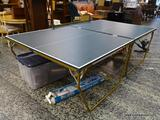 (R1) VINTAGE SUPER BRUTE PING PONG BALL TABLE TENNIS. THE TABLE IS SUPPORTED BY A METAL FRAME. FOLDS