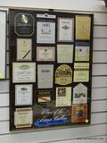 (R1) WINE ADVERTISING PRINT WITH A BRASS FRAME. MEASURES 19 IN X 26 IN. ITEM IS SOLD AS IS WHERE IS