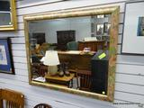 (R1) FLORAL FRAMED AND BEVELED GLASS MIRROR. MEASURES 36 IN X 30 IN. ITEM IS SOLD AS IS WHERE IS