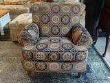 (R1) HICKORY HOUSE FURNITURE CO. FLORAL AND GEOMETRIC UPHOLSTERED ARM CHAIR WITH REEDED LEGS.
