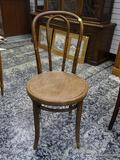 (R1) BENTWOOD SIDE CHAIR WITH PLANK BOTTOM SEAT. MEASURES 16.5 IN X 17 IN X 35 IN. ITEM IS SOLD AS