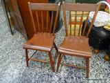(R1) PAIR OF CHERRY FINISH PLANK BOTTOM AND ARROW BACK SIDE CHAIRS. MEASURE 18 IN X 18 IN X 35 IN.