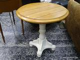 (R1) MAPLE AND CREAM PAINTED PEDESTAL BASE END TABLE. MEASURES 27 IN X 28 IN. ITEM IS SOLD AS IS,