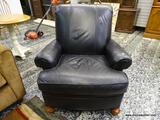 (R1) LEATHER UPHOLSTERED ARM CHAIR WITH MAHOGANY CARVED FEET. MEASURES 35 IN X 38 IN X 36 IN. ITEM