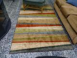 (R1) MODERN ABSTRACT PATTERN AREA RUG. MEASURES 5 FT X 8 FT. ITEM IS SOLD AS IS WHERE IS WITH NO