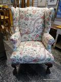 (R1) FLORAL UPHOLSTERED WING BACK CHAIR WITH MAHOGANY BALL & CLAW STYLE FEET. MEASURES 31 IN X 32 IN