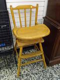 (R2) MAPLE HIGH CHAIR WITH SPINDLE LEGS. MEASURES 17 IN X 21 IN X 38 IN. ITEM IS SOLD AS IS WHERE IS