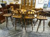 (R1) SET OF 4 PINE SWIVEL BAR CHAIRS WITH LOWER FOOT RESTS. EACH MEASURES 22 IN X 21 IN X 40.5 IN.