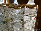 (R1) SET OF 11 GOLD RIMMED WINE GLASSES. ITEM IS SOLD AS IS, WHERE IS, WITH NO GUARANTEE OR
