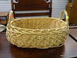 (R1) DOUBLE HANDLED WOVEN WICKER BASKET. ITEM IS SOLD AS IS, WHERE IS, WITH NO GUARANTEE OR