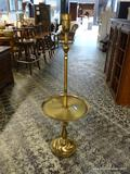 (R1) BRASS FLOOR LAMP WITH BUILT IN END TABLE. MEASURES 53 IN TALL. ITEM IS SOLD AS IS WHERE IS WITH