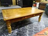 (R1) PINE FINISHED COFFEE TABLE WITH 1 DRAWER WITH WOODEN KNOB STYLE PULLS. MEASURES 48 IN X 28 IN X