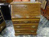 (R1) OAK FALL-FRONT DESK WITH 3 DRAWERS, BRASS TONE PULLS, AND INTERIOR CUBBY STORAGE. MEASURE 30 IN