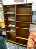 (R1) 10 SHELF DOUBLE BOOKCASE. MEASURES 47.5 IN X 12.5 IN X 76.25 IN. NEEDS TLC. ITEM IS SOLD AS IS