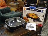 (R1) BLACK & DECKER ELECTRIC SKILLET. MODEL SKG100. HAS BOX. ITEM IS SOLD AS IS WHERE IS WITH NO