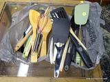 (R1) BAG LOT OF KITCHEN TOOLS TO INCLUDE SPATULAS, WOODEN SPOONS, WHISKS, ETC. ITEM IS SOLD AS IS