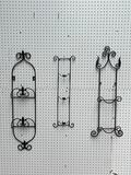 (S12L) METAL WALL HANGING VERTICAL PLATE RACKS WITH LEAF AND FLEUR DE LIS DESIGNS; RANGING FROM 25