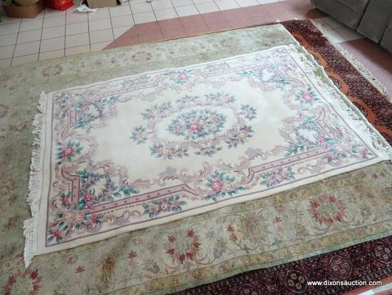 HANDMADE CHINESE SCULPTED AREA RUG IN IVORY, MAUVE AND GREEN. MEASURES APPROXIMATELY 5 FT 7 IN X 9