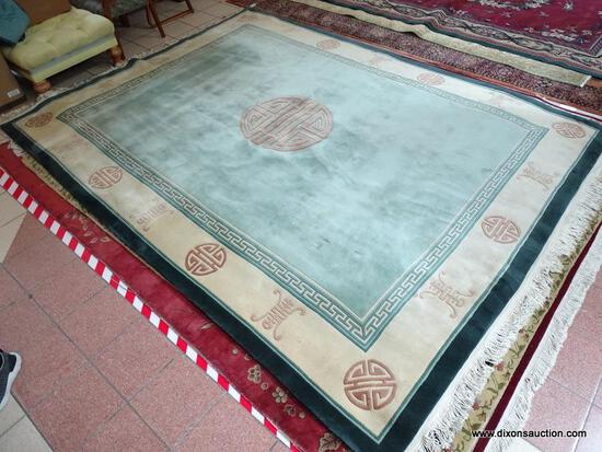 HANDMADE SCULPTED CHINESE RUG IN GREEN, IVORY AND BEIGE WITH CHINESE SCRIPT. MEASURES APPROXIMATELY