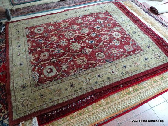 MACHINE MADE ORIENTAL STYLE AREA RUG IN MAROON, IVORY, AND GREEN. MEASURES APPROXIMATELY 7 FT 10 IN