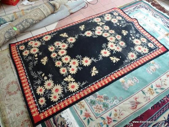 MACHINE MADE HOOK RUG WITH FLOWERS AND BEES IN BLACK, IVORY, AND RED. MEASURES APPROXIMATELY 5 FT X