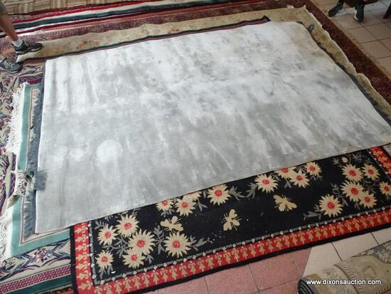 ESTATE OWNED HANDMADE GRAY AREA RUG. MADE IN INDIA. MEASURES APPROXIMATELY 6 FT 3 IN X 9 FT 9 IN.