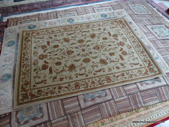 MACHINE MADE ORIENTAL STYLE AREA RUG IN BEIGE AND RUST. IN THE SPHINX PATTERN. MEASURES