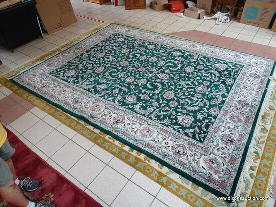 HANDMADE ORIENTAL BOKHARA IN GREEN, IVORY, AND MAUVE. MEASURES APPROXIMATELY 8 FT 11 IN X 12 FT.