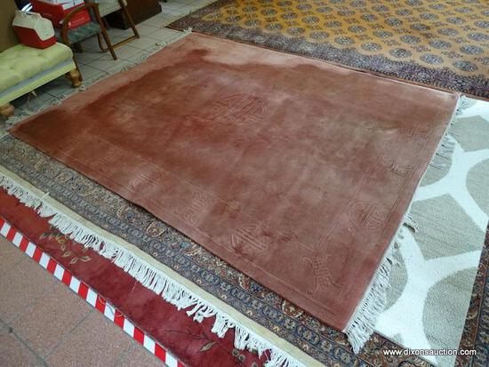 ESTATE OWNED MACHINE MADE MAUVE ORIENTAL SCULPTED RUG. MEASURES APPROXIMATELY 7 FT 11 IN X 10 FT 6