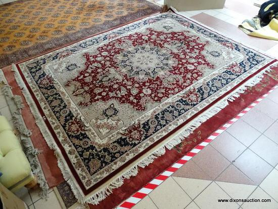 TIGHTLY WOVEN HANDMADE PERSIAN IN MAROON, IVORY, AND BLUE FLORAL WITH LARGE FLORAL MEDALLION.