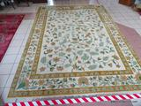 CHINESE SCULPTED AREA RUG IN IVORY, GREEN, AND FLORAL. MEASURES APPROXIMATELY 10 FT X 14 FT. ITEM IS