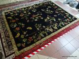 CAPEL MACHINE MADE KALEEN WOOL RUG. MADE IN NEW ZEALAND IN THE FLORAL GARDEN PATTERN. IN NAVY BLUE,
