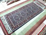 HANDMADE PERSIAN IN BLUE, MAROON, AND IVORY. MEASURES APPROXIMATELY 2 FT 7 IN X 6 FT 4 IN. ITEM IS