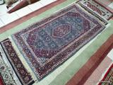 HANDMADE INDIAN AREA RUG IN MAROON, BLUE, AND IVORY. MEASURES APPROXIMATELY 3 FT 6 IN X 5 FT 4 IN.