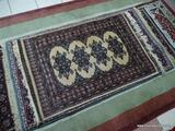 HANDMADE BOKHARA. IS FINELY WOVEN IN IVORY, BLUE, AND MAUVE. MEASURES APPROXIMATELY 2 FT 8 IN X 4 FT