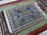HANDMADE IRANIAN AREA RUG IN IVORY, BLUE, AND BROWN. MEASURES APPROXIMATELY 2 FT 11 IN X 4 FT 6 IN.
