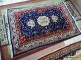 HANDMADE PERSIAN IN BLUE, RED, AND IVORY. MEASURES APPROXIMATELY 4 FT 1 IN X 6 FT 2 IN. ITEM IS SOLD