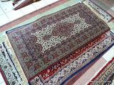 MACHINE MADE TABRIS IN MAROON, BLUE, AND IVORY. MEASURES APPROXIMATELY 3 FT X 6 FT 5 IN. ITEM IS
