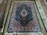 HANDMADE TABRIS IN GREEN, IVORY, AND RED. MEASURES APPROXIMATELY 4 FT X 6 FT 7 IN. ITEM IS SOLD AS