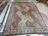 MACHINE MADE ORIENTAL STYLE RUG IN BROWN, IVORY, AND RED. MEASURES APPROXIMATELY 7 FT 8 IN X 10 FT 1