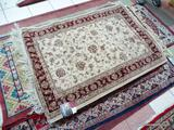 MACHINE MADE ORIENTAL STYLE RUG IN MAROON, IVORY, AND BROWN. MEASURES APPROXIMATELY 3 FT 3 IN X 5