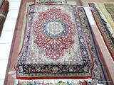 HANDMADE PERSIAN IN RED, IVORY, AND BLUE. MEASURES APPROXIMATELY 3 FT 10 IN X 5FT 9 IN. ITEM IS SOLD