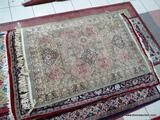ESTATE OWNED MACHINE MADE SILK RUG IN SAGE, MAUVE, AND IVORY. MADE IN BELGIUM. MEASURES