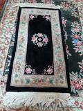 ESTATE OWNED HAND KNOTTED CHINESE SCULPTED RUG IN BLACK, IVORY, AND GREEN. MEASURES APPROXIMATELY 5