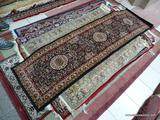 MACHINE MADE ISFAHAN IN BLACK, MAROON, AND IVORY. MEASURES 2 FT X 7 FT 7 IN. ITEM IS SOLD AS IS