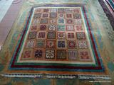 HANDMADE ORIENTAL RUG IN BROWN, IVORY, AND RED WITH BEIGE COLORED TASSELS. MEASURES APPROXIMATELY 6