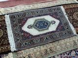 HAND KNOTTED PERSIAN IN IVORY, BLUE, AND RED. MEASURES APPROXIMATELY 1 FT 10 IN X 3 FT 3 IN. ITEM IS