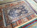HANDMADE PERSIAN IN BLUE, IVORY AND BROWN. MEASURES APPROXIMATELY 3 FT 1 IN X 5 FT 7 IN. ITEM IS